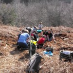 Young Archaeologists excavating