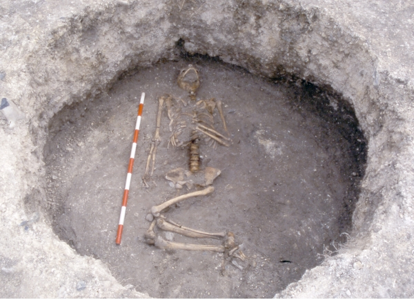 Burial of a woman in the fill of an Iron Age grain storage pit at North Foreland, Broadstairs