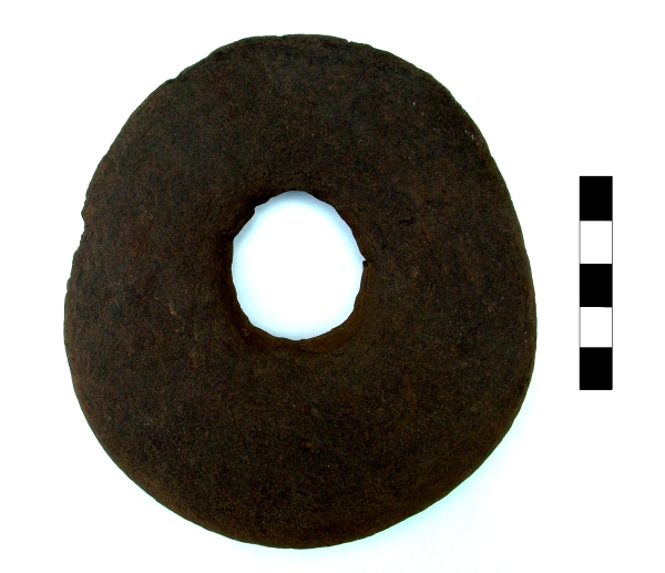 Kimmeridge shale perforated disc, later Saxon or Viking period.