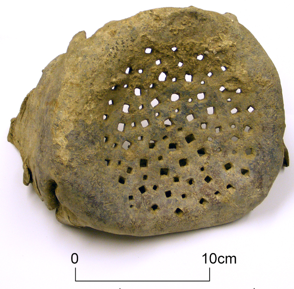 Perforated lead drain cover from Roman villa at Minster